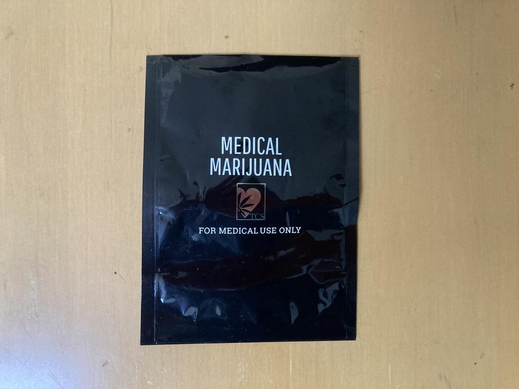 a medical marijuana plastic bag lying on a table