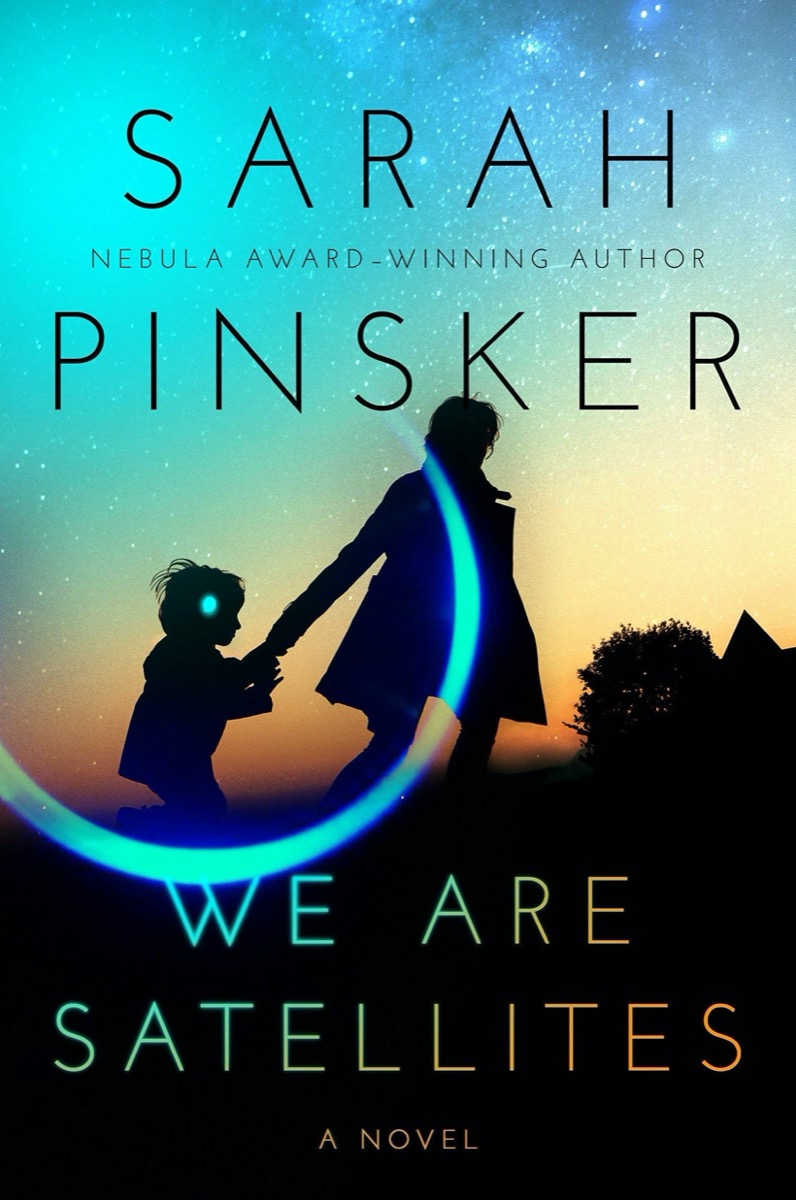 """a book cover two shadowed figures of an adult holding a child's hand with a silhouette of a house and a tree in a background. behind is a sunset with stars. there is a reflective circle and dot surrounding the child's head. the title reads """"we are satellites"""" by sarah pinsker."""