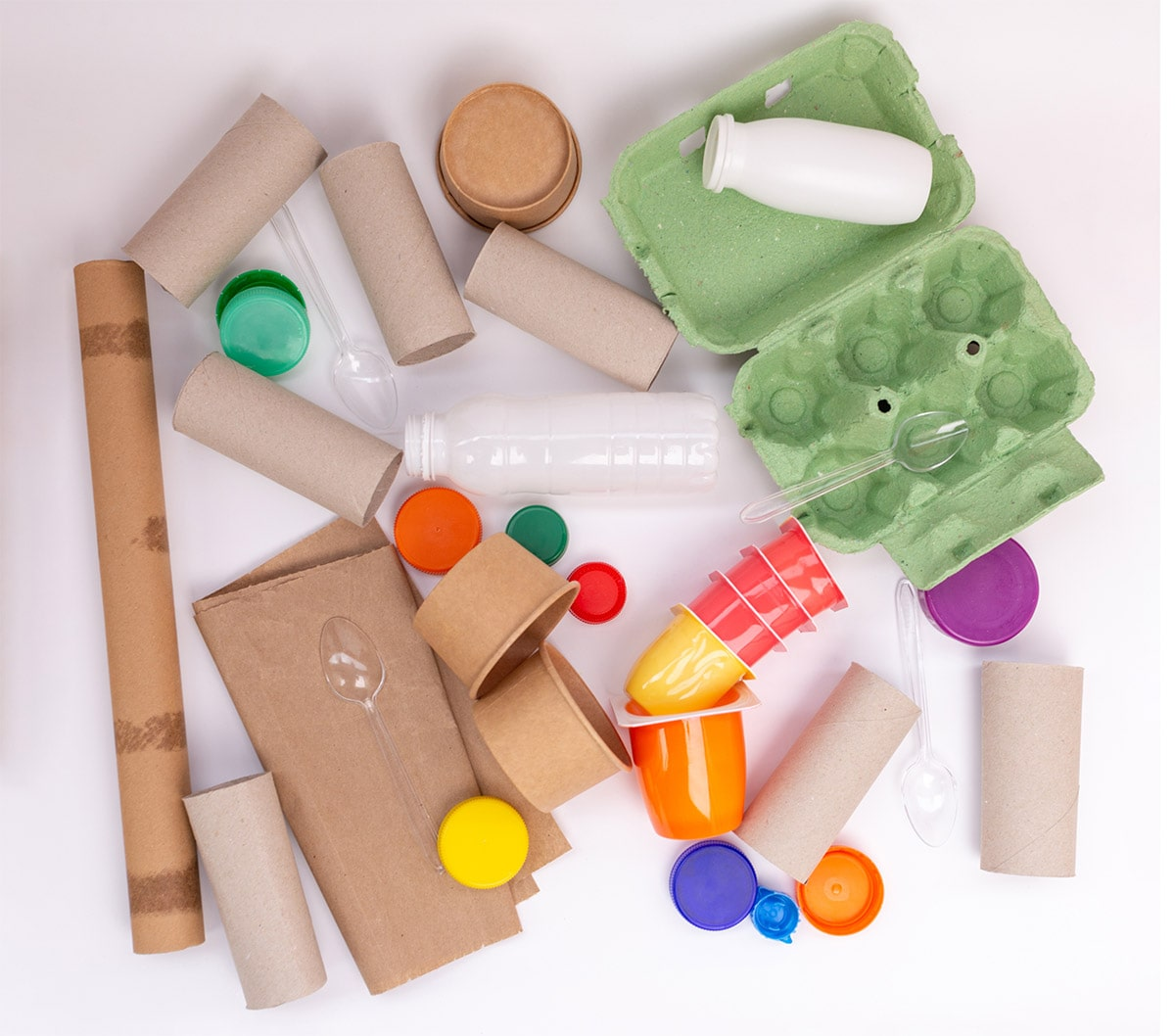 Paper, plastic, and cardboard recyclables in a pile.