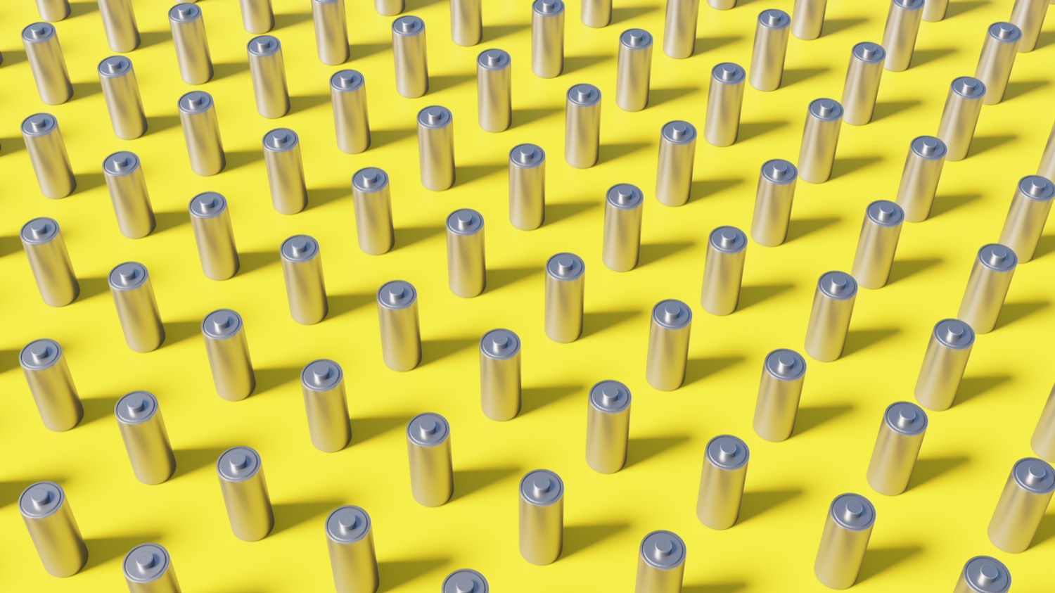 dozens of rows of AA batteries on a yellow background