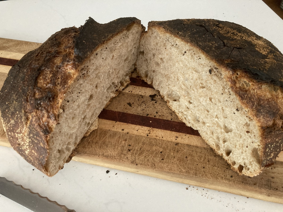 a loaf of sourdough bread sliced in the middle to see its rich density