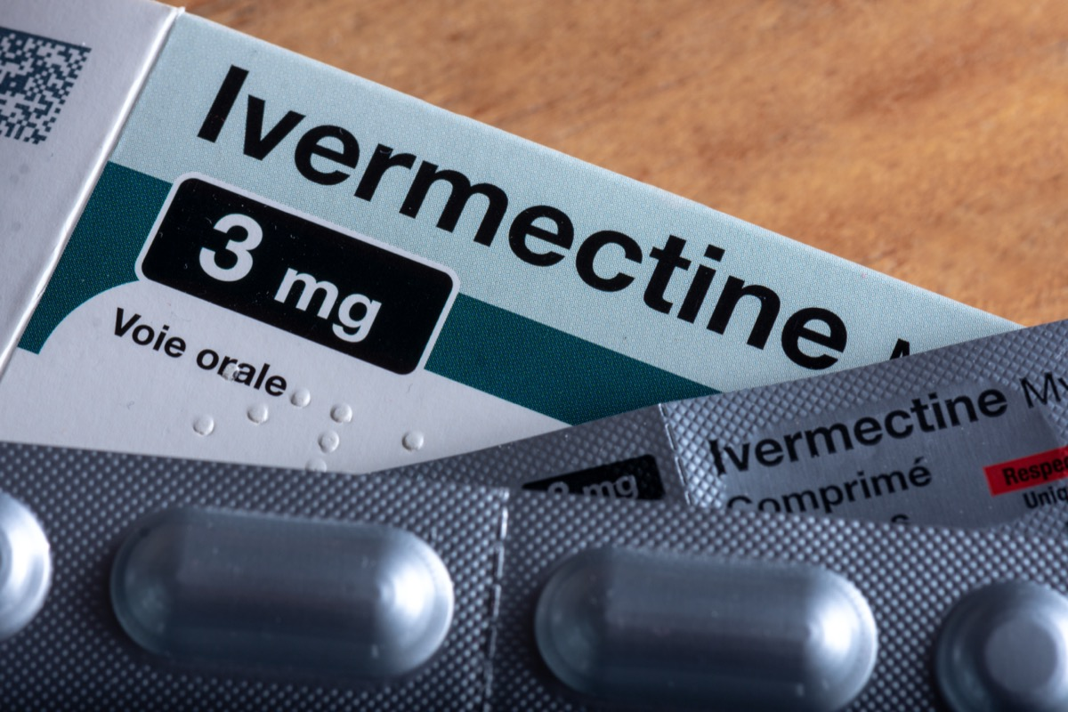 a box of medicine labeled ivermectin with pill packets lying on top