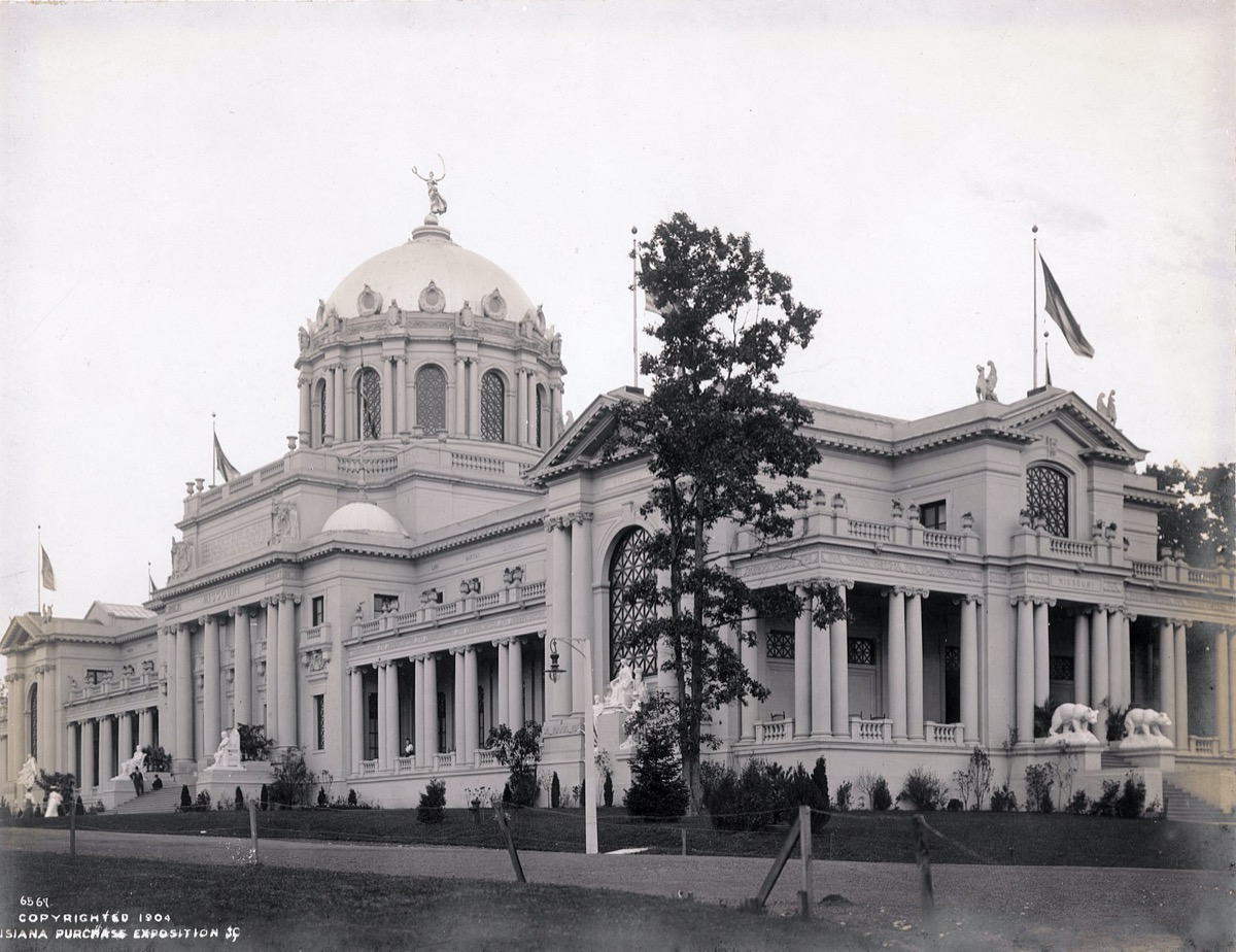 a black and white photo of an opulent building with a large rotunda and pillars