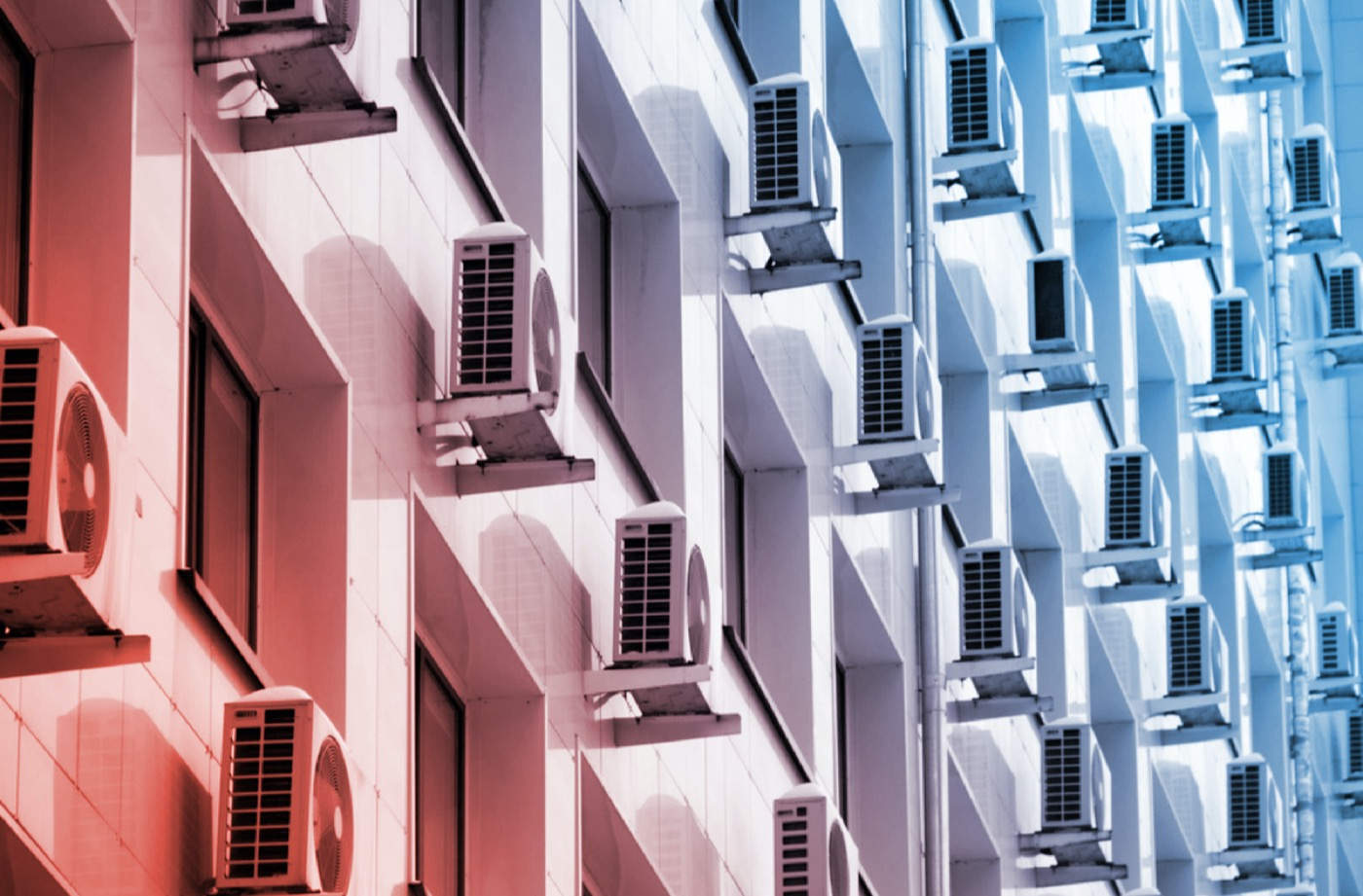 On the facade of the office building there are white air conditioners at the Windows. Concept of indoor climate and air circulation